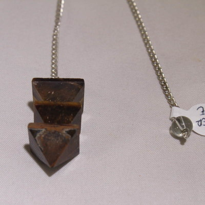 Tiger Eye  (Layered Pyramid) Pendulum  with clear crystal bead on the end of the chain.